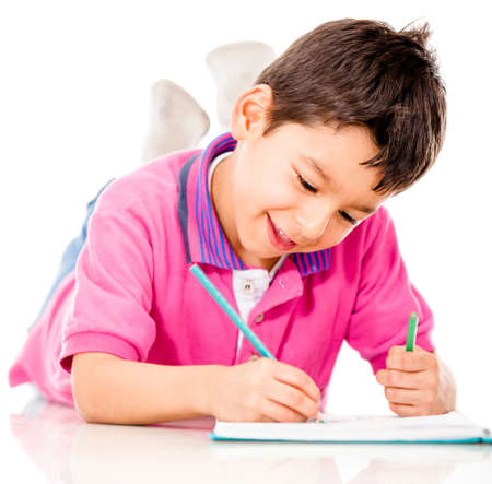 Boy lying on the floor coloring - isolated over a white background  photo