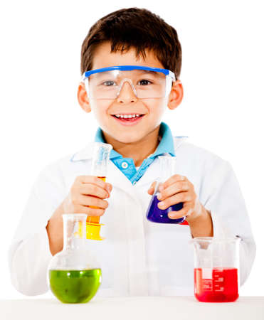 Boy doing experiments at the lab - isolated over a white background  photo