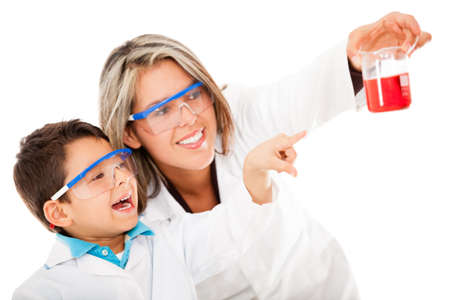 Boy helping mum with an experiment at the lab - isolated over white  Stock Photo - 13761831