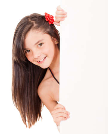 latin girls: Beautiful girl holding a banner and smiling - isolated over a white background  Stock Photo