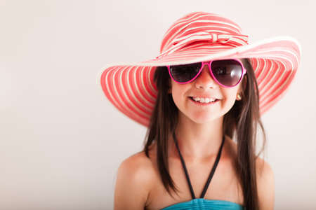 Happy summery girl wearing a hat and sunglasses  photo