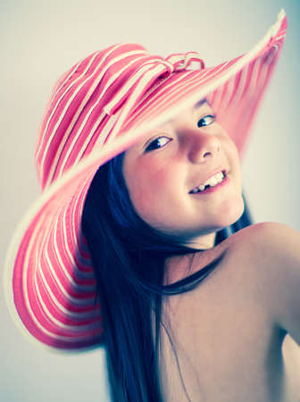 Portrait of summer girl wearing a hat and flirting  photo