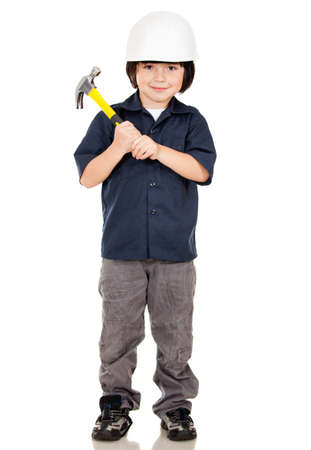 Boy playing to be construction builder - isolated over a white background  photo