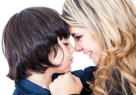 eskimo woman: Potrait of a mother and son giving an eskimo kiss - isolated over white