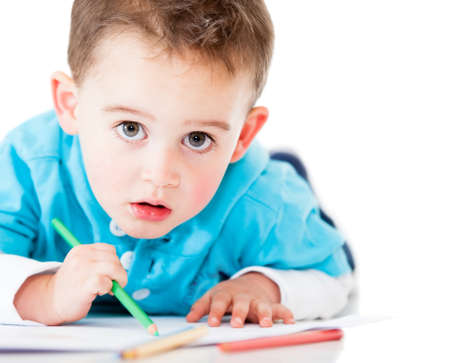 Little boy coloring - isolated over a white background Stock Photo - 13786021
