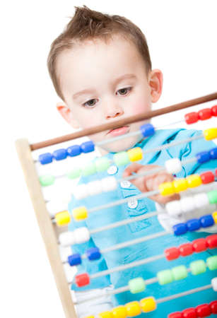 Boy playing with an abacus - isolated over a white background photo