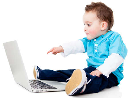 Boy pointing at the screen of a laptop computer - isolated over white  photo