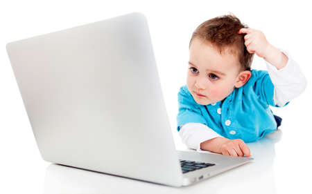 Confused boy with a laptop computer - isolated over a white background  photo