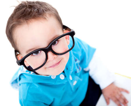 Funny boy wearing big glasses - isolated over a white background  photo