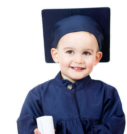 Little boy graduating in a blue gown - isolated over white  photo