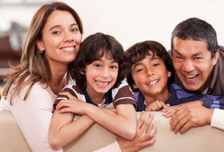 Portrait of a happy family together at home smiling Stock Photo - 13786119