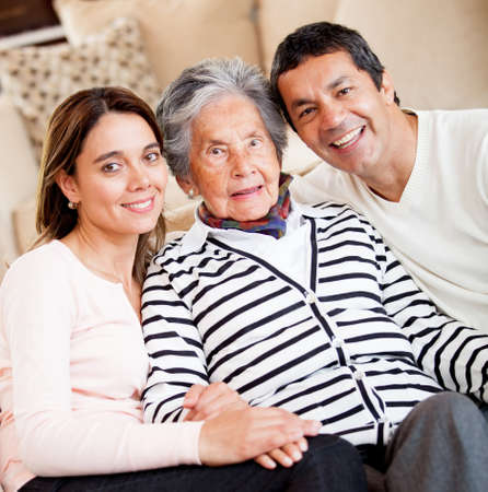 Lovely portrait of a grandmother with her family at home  photo