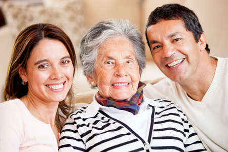 Beautiful portrait of a mother, son and daughter-in-law smiling  photo