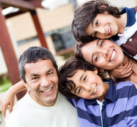 latin: Portrait of a beautiful family looking happy  Stock Photo