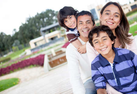 Portrait of a beautiful family smiling outdoors  photo