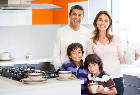 Family in the kitchen having breakfast at home  photo