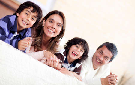 Happy family enjoying their time together at home  photo