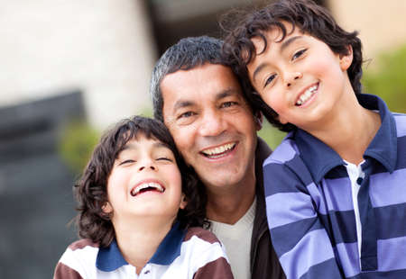 Portrait of a happy father with his two sons  photo