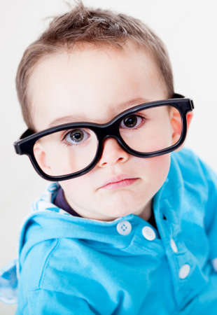 Little boy wearing big glasses - isolated over a white background  photo