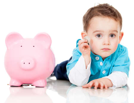 coinbank: Boy saving money in a piggybank - isolated over a white background Stock Photo