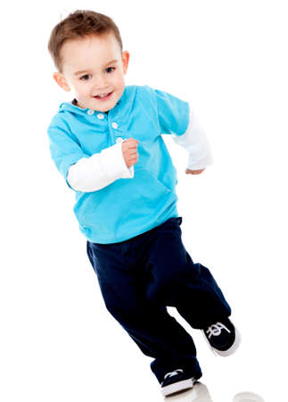 running race: Happy little boy running - isolated over a white background