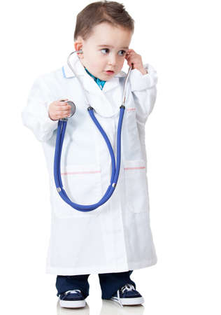 Boy playing doctor with a stethoscope - isolated over white  photo