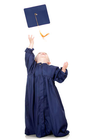 Boy throwing mortarboard - isolated over a white background  photo
