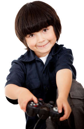 Boy playing video games and holding a control - isolated over a white background  photo