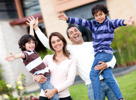 Excited family having fun outdoors with arms up  photo