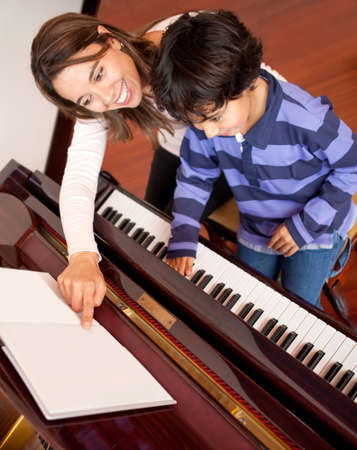 lesson: Young boy taking piano lessons at home