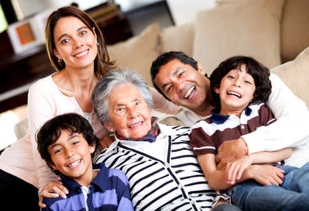 Beautiful three-generation family smiling at home  photo