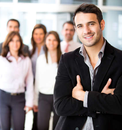 Successful businessman at the office leading a group Stock Photo - 13861582
