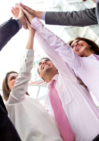 Successful business group celebrating with hands together - teamwork concepts  Stock Photo - 13861764