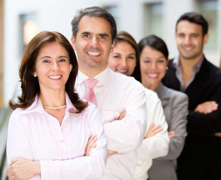 Successful business team at the office looking happy  Stock Photo - 13861583