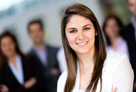 Successful young woman leading a business team  Stock Photo - 13861588