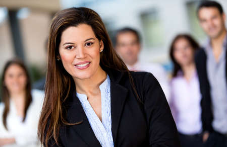Successful woman at the office leading a business group Stock Photo - 13861866