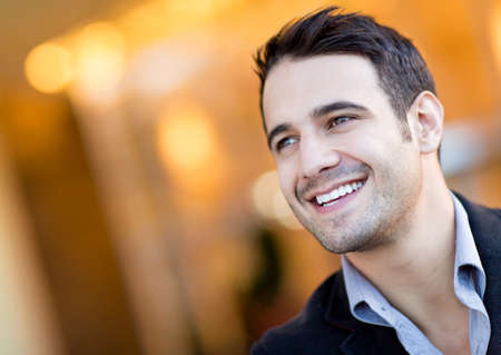 Portrait of a handsome man looking very happy  Stock Photo - 13860507