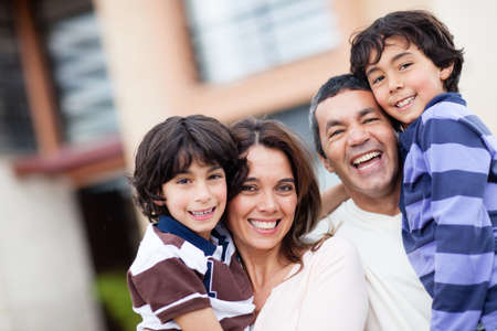 Beautiful family portrait smiling ad looking very happy  Stock Photo - 13861856