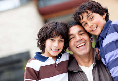 single parent family: Beautiful family portrait with a group boys smiling