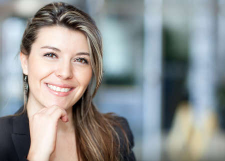 young office workers: Portrait of a young confident business woman smiling