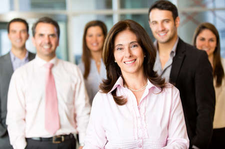 office worker: Business woman with her team at the office