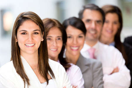 Successful business group in a row smiling  Stock Photo - 13877106