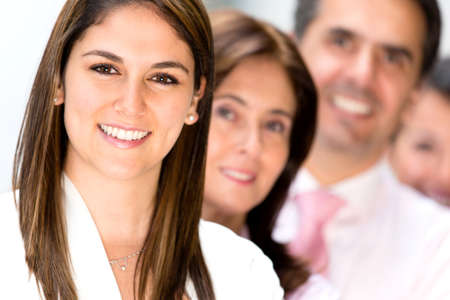 Friendly business team at the office looking very happy  Stock Photo - 13877091