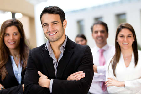 successful leadership: Confident male business leader with his team