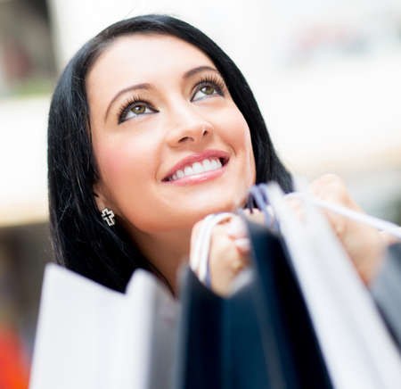 Happy female shopper holding bags at the shopping center  Stock Photo - 13899543