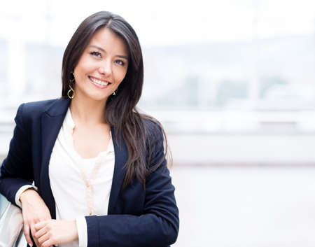 business woman: Successful business woman looking confident and smiling