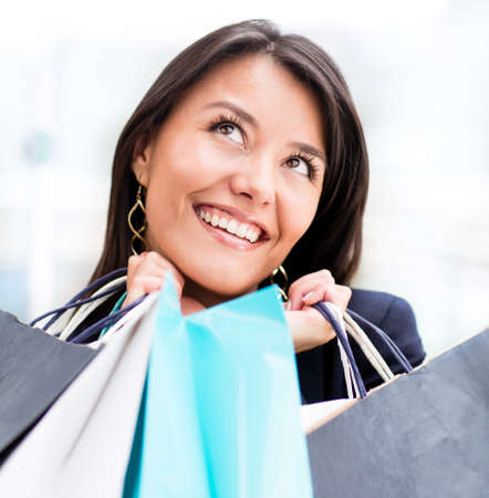 Excited woman shopping holding bags and looking up  Stock Photo - 13899599