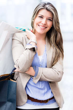 shoppingbag: Happy shopping woman at the mall holding bags