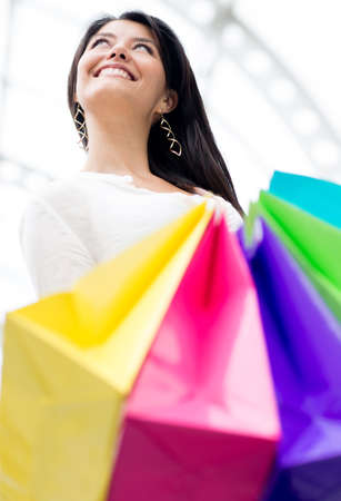 Happy Latin woman shopping and holding bags  Stock Photo - 13899546