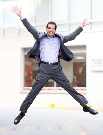 Excited business man jumping and looking very happy  photo